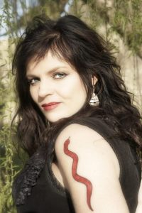 Wendy Rule with temporary snake tatoo
